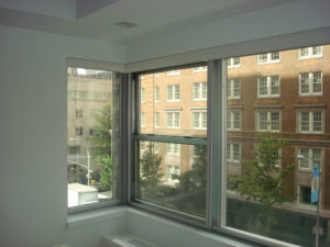 Cityproof Soundproof Windows combo stationary and 3 panel sliding with 90 degree Corner Section - Upper Manhattan, NY
